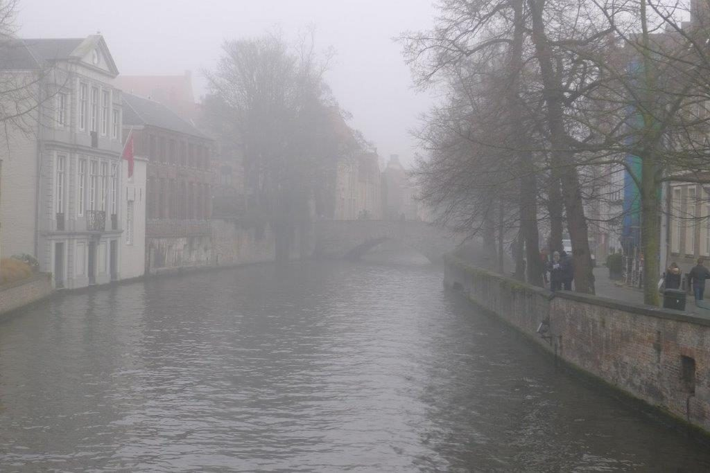 Bruges canal in the fog