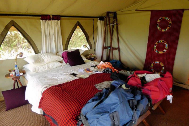 Inside tent with bed