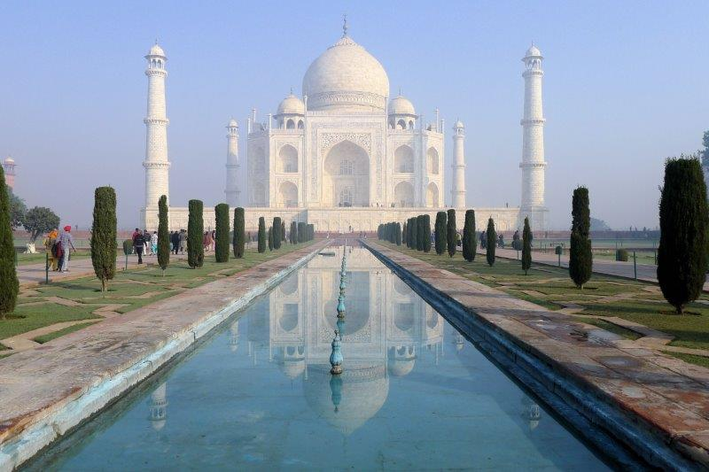 Taj reflected in the pools.