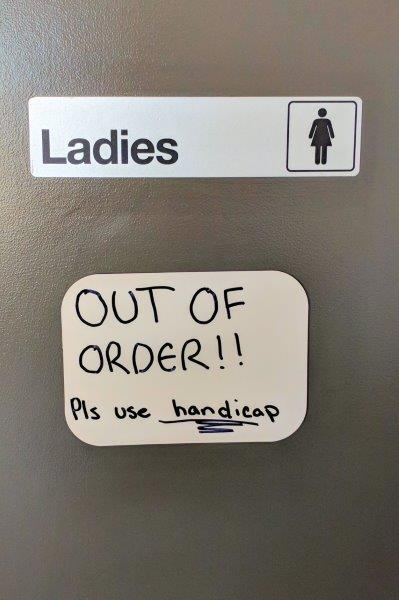 Ladies out of order sign