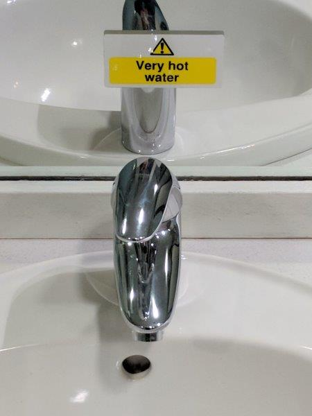 scotland hot water sign in a sink