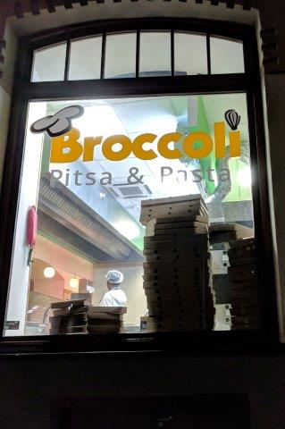Window into Broccoli pizza