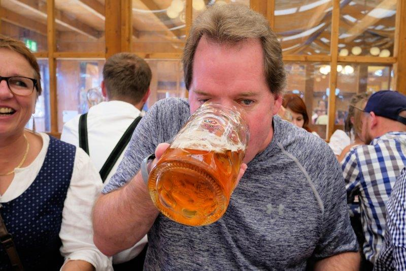 Mark drinking a stein of beer.