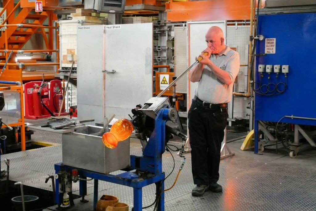 A man blowing glass in the Waterford factory