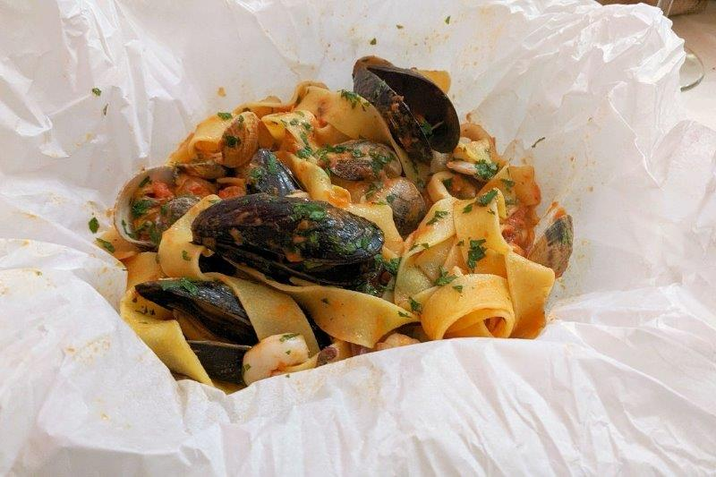 Pasta and seafood in a paper wrapper